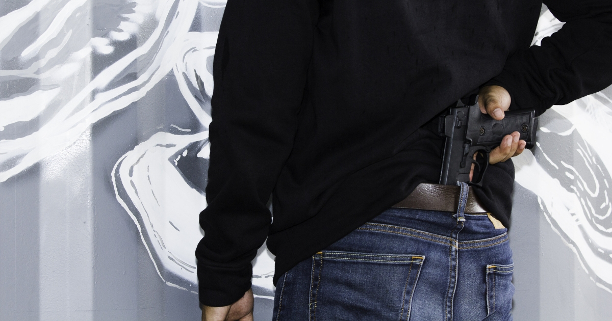 A man carrying a concealed handgun