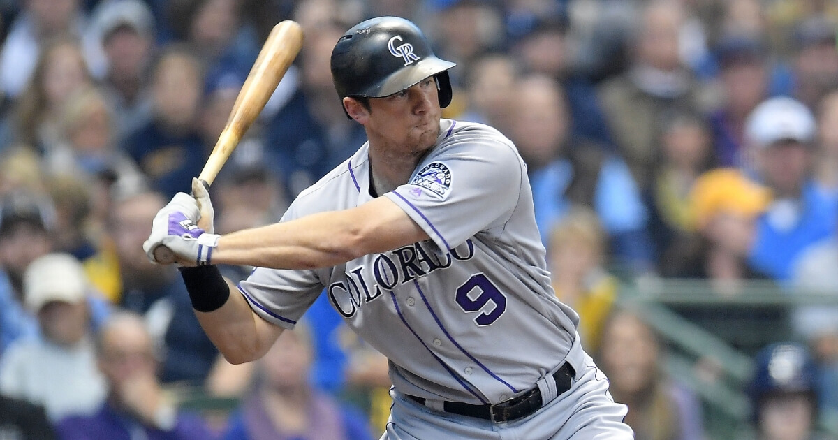 D.J. LeMahieu bats for the Colorado Rockies in Game 2 of the NL Divisional Series against the Milwaukee Brewers at Miller Park on Oct. 5, 2018.