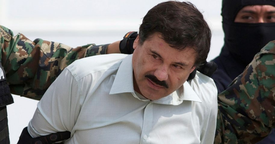 "Joaquin ""El Chapo"" Guzman, the head of Mexico's Sinaloa Cartel, is escorted to a helicopter in Mexico City following his capture in 2014."