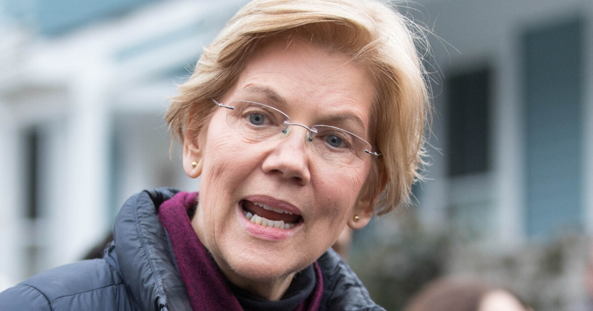 Sen. Elizabeth Warren, D-Mass., addresses the media outside of her home in Cambridge on Monday after announcing she formed an exploratory committee for a 2020 presidential run.