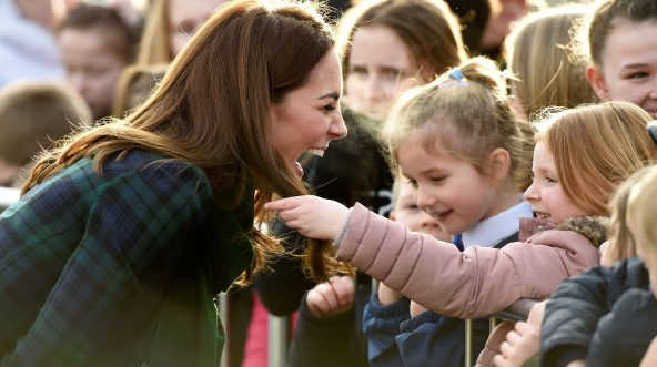 Britain's Catherine, Duchess of Cambridge reacts as a young girl touches her hair whilst she greets well-wishers outside of a community center in Dundee, eastern Scotland, on Jan. 29, 2019.