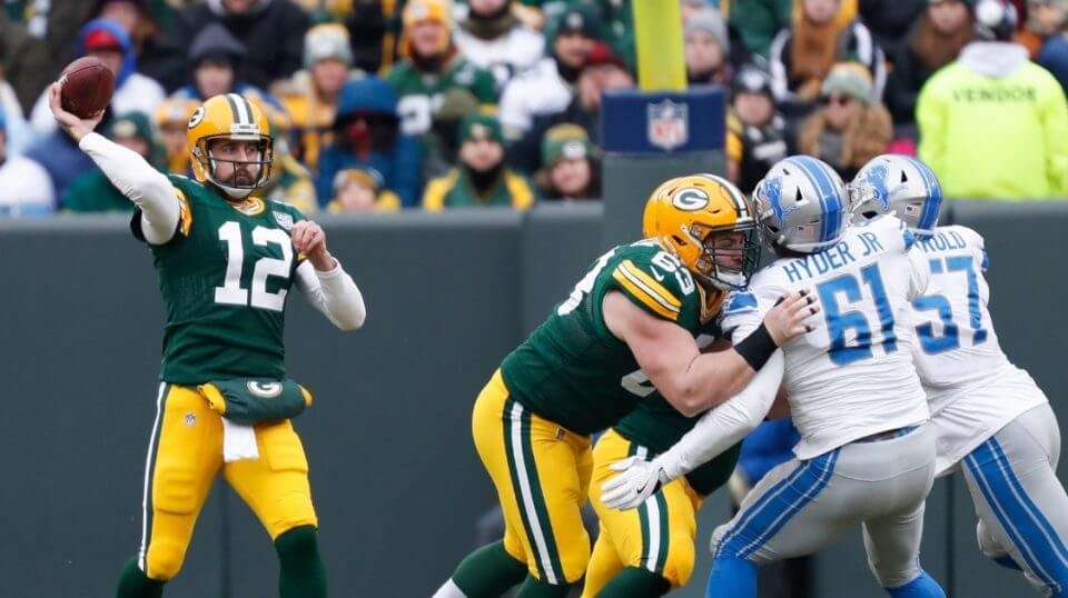 Green Bay Packers' Aaron Rodgers throws during the first half of an NFL football game against the Detroit Lions on Dec. 30, 2018, in Green Bay, Wisconsin.