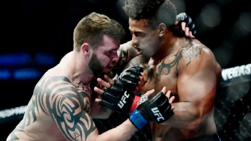 Greg Hardy, right, fights Allen Crowder during a heavyweight bout at Saturday's UFC Fight Night at Barclays Center in New City.