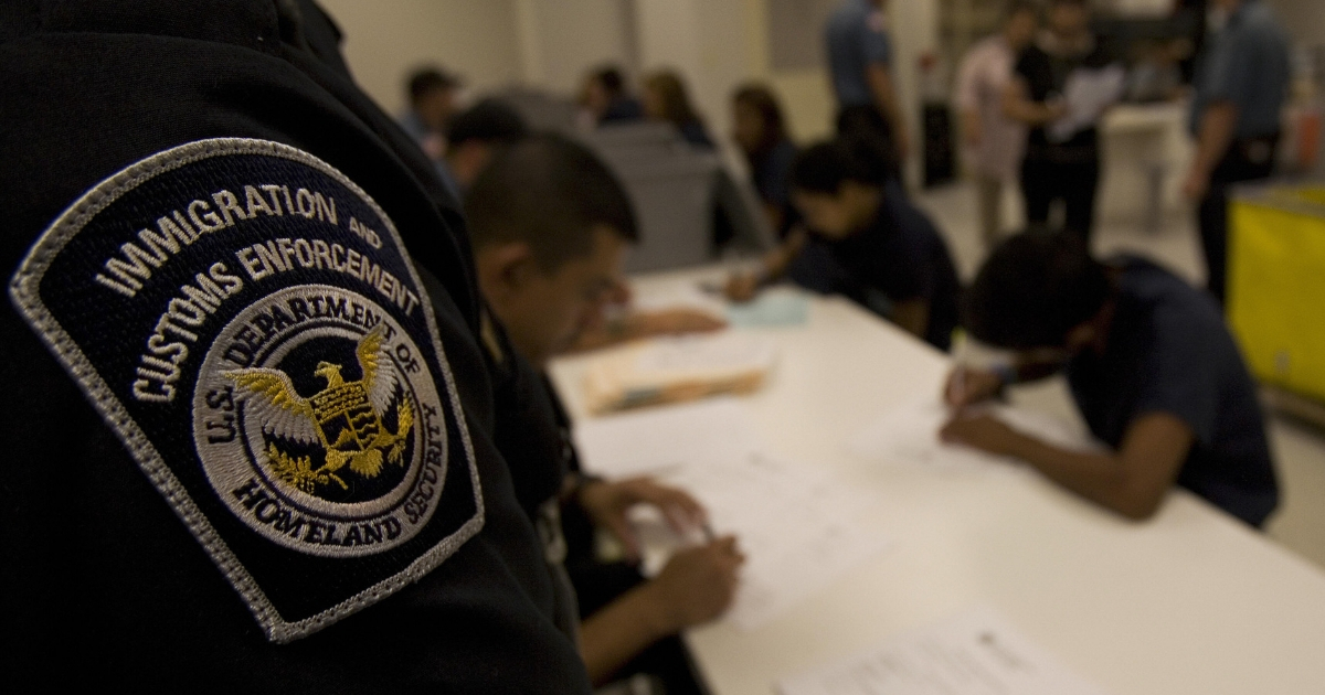 Guards process new detainees inside Homeland Security's Willacy Detention Center, a facility with 10 giant tents that can house up to 2000 detained illegal immigrants, May 10 2007, in Raymondville, Texas.