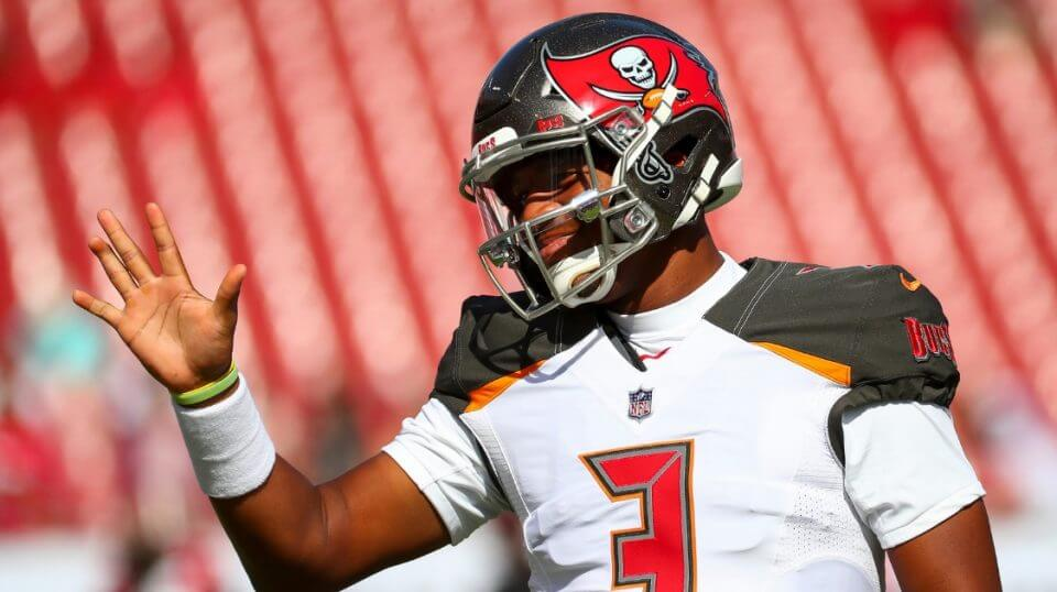 Quarterback Jameis Winston of the Tampa Bay Buccaneers waves to a fan during warmups before a Nov. 25 game against the San Francisco 49ers at Raymond James Stadium.