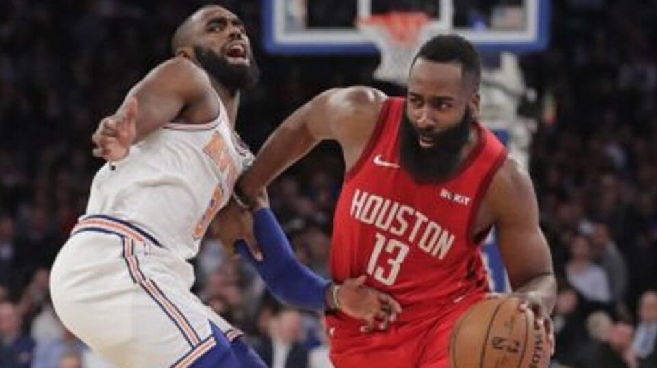 Houston Rockets' James Harden drives past New York Knicks' Tim Hardaway Jr. during the first half of Wednesday's game ast Madison Square Garden.
