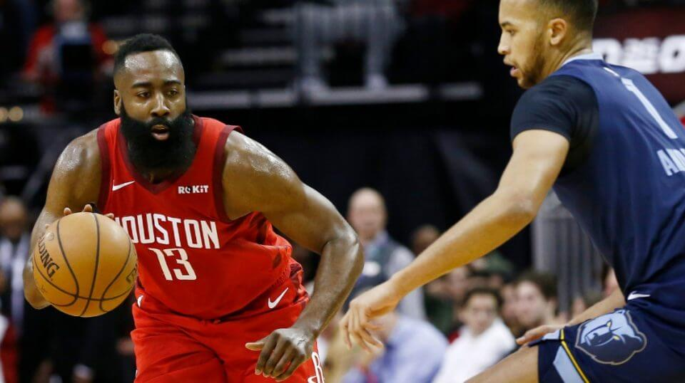 James Harden of the Houston Rockets drives around Kyle Anderson of the Memphis Grizzlies during Monday's game at Toyota Center.