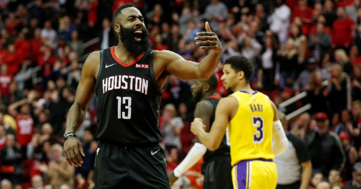 James Harden #13 of the Houston Rockets reacts in overtime against the Los Angeles Lakers at Toyota Center on Saturday in Houston, Texas.