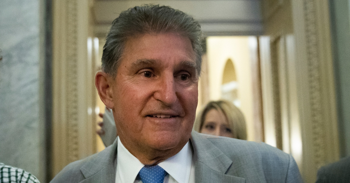 Sen. Joe Manchin heads to the Senate floor for a vote, at the U.S. Capitol, Oct. 3, 2018, in Washington, D.C.
