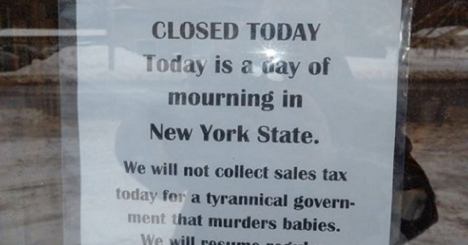 A sign posted at a Syracuse, New York, book store announces the business was closed on Wednesday to protest a liberal new abortion measure signed into law by Democratic Gov. Andrew Cuomo on Tuesday.