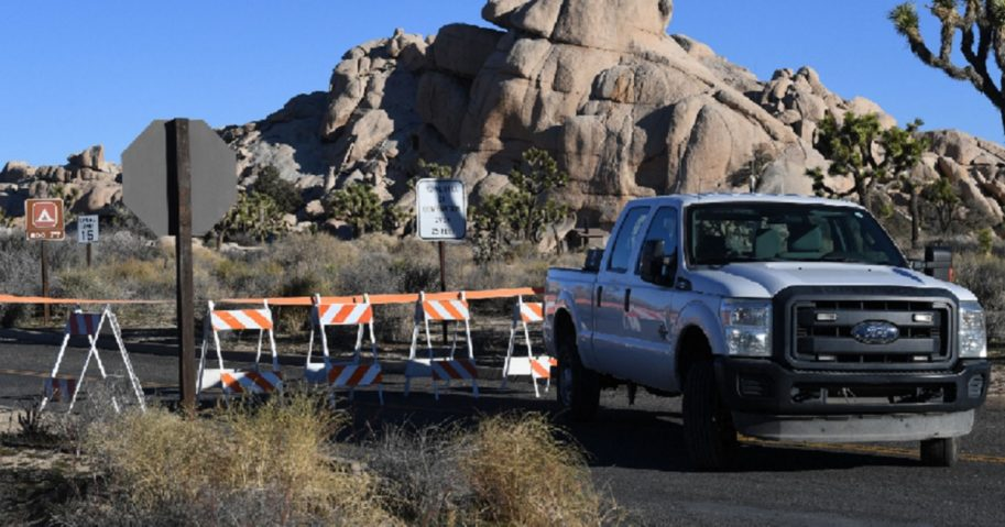 A National Partk Service truck and barricades block a road in California's Joshua Tree National Park during the partial government shutdown.