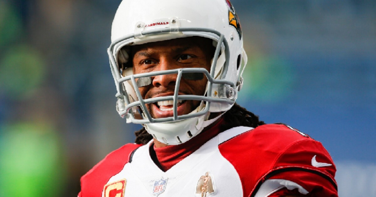 Arizona Cardinals wide receiver Larry Fitzgerald warms up before a game against the Seattle Seahawks on Dec. 30.