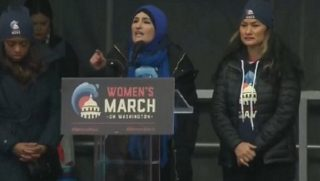 Women's March leader Linda Sarsour addresses the rally Saturday in Washington.