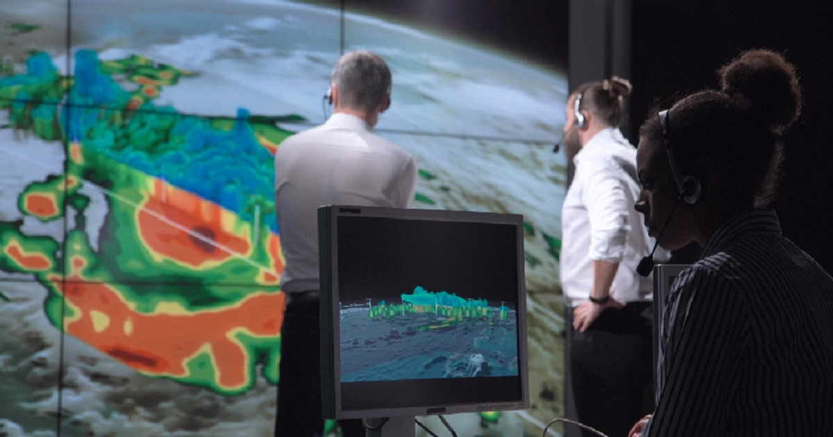 Meteorologists study weather patterns in a stock file photo.