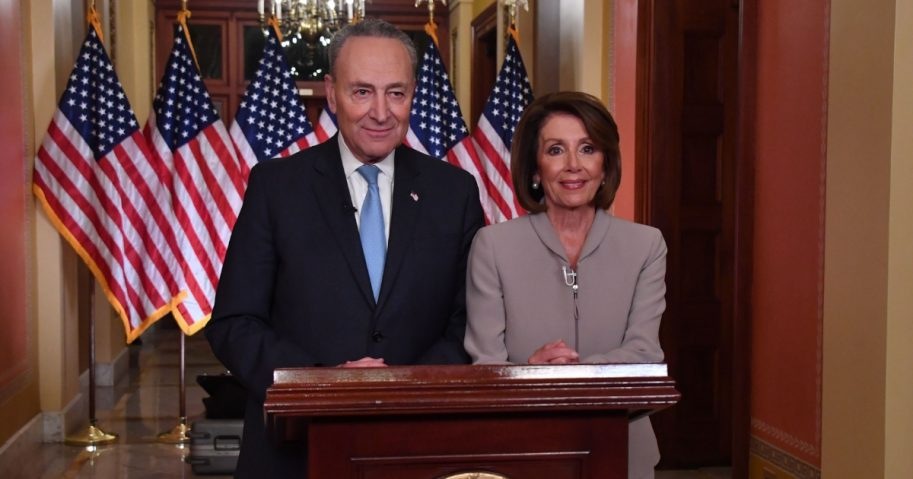 House Speaker Nancy Pelosi and Senate Democratic leader Chuck Schumer pose for pictures after delivering a response to President Donald Trump's televised address to the nation on border funding at the Capitol in Washington D.C. on Jan. 8, 2019.