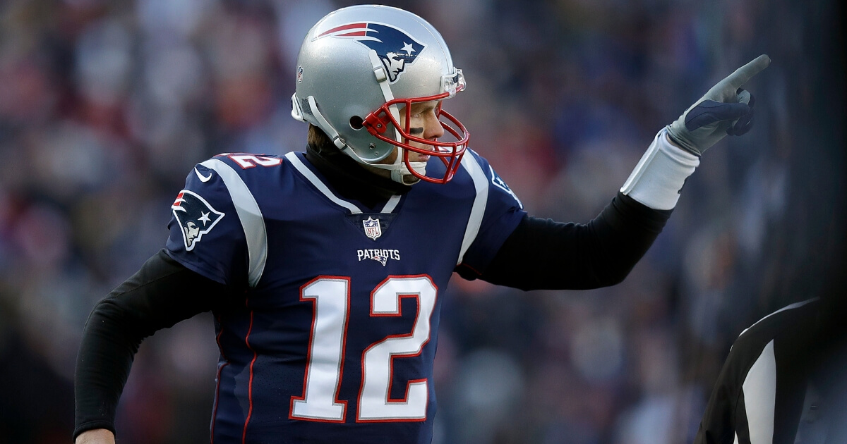 New England Patriots quarterback Tom Brady celebrates one of his team's five first-half touchdowns against the Los Angeles Chargers during the first half of an NFL divisional playoff football game, Jan. 13, 2019, in Foxborough, Massachusetts.