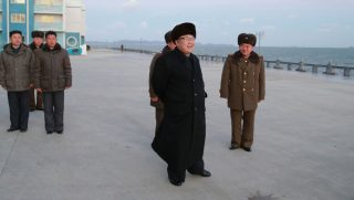 This undated picture released from North Korea's official Korean Central News Agency (KCNA) on January 15, 2017 shows North Korean leader Kim Jong-Un (C) inspecting the newly-built Kumsanpho Fish Pickling Factory and Kumsanpho Fishery Station.