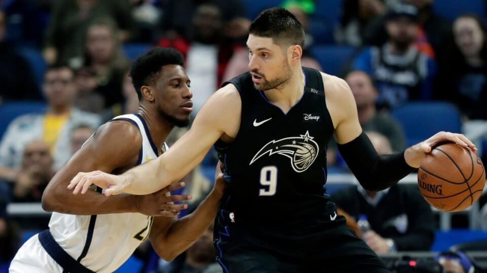 Orlando Magic's Nikola Vucevic looks for a way to the basket against the Indiana Pacers' Thaddeus Young during a game Thursday in Orlando, Florida. Vucevic is one of four first-time NBA All-Stars and the first Magic player to make the game since Dwight Howard in 2012.