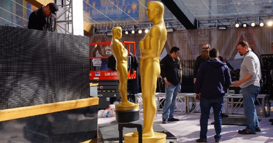 Two large Oscars statues are prepared for the 2017 Academy Awards ceremony.