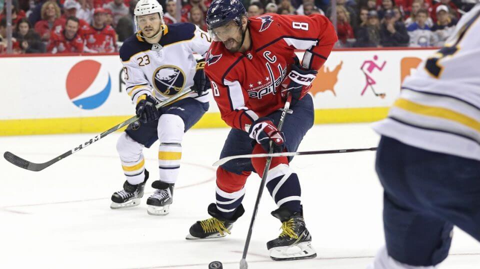 Alex Ovechkin of the Washington Capitals skates past Sam Reinhart of the Buffalo Sabres during a Dec. 15 game at Capital One Arena.