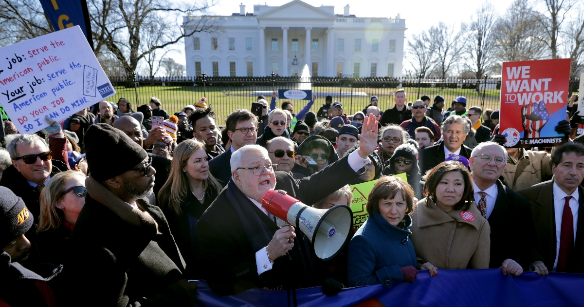 American Federation of Government Employees National President David Cox speaks on megaphone as hundreds of federal workers and contractors and members of Congress rally against the partial federal government shutdown in front of the White House Jan. 10, 2019, in Washington, D.C.