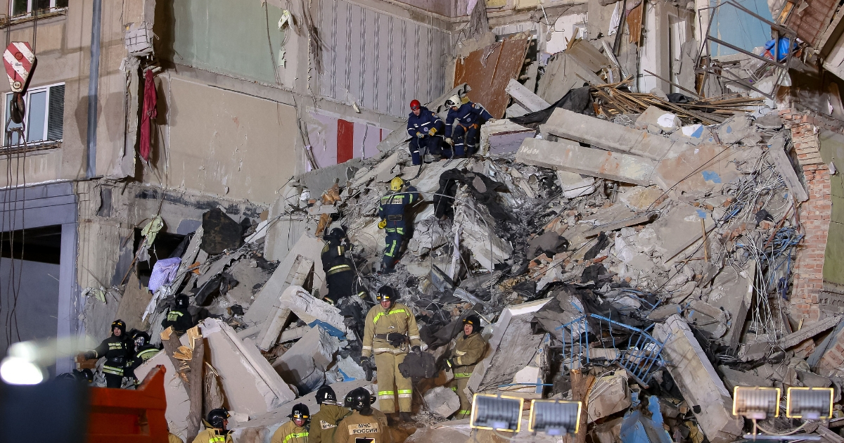 Emergency officers inspect rubble as they take part in a rescue operation after a gas explosion rocked a residential building in Russia's Urals city of Magnitogorsk on Dec. 31, 2018.