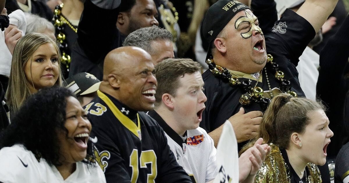 New Orleans Saints fans cheer for their team during the NFC championship game against the Los Angeles Rams on Sunday.