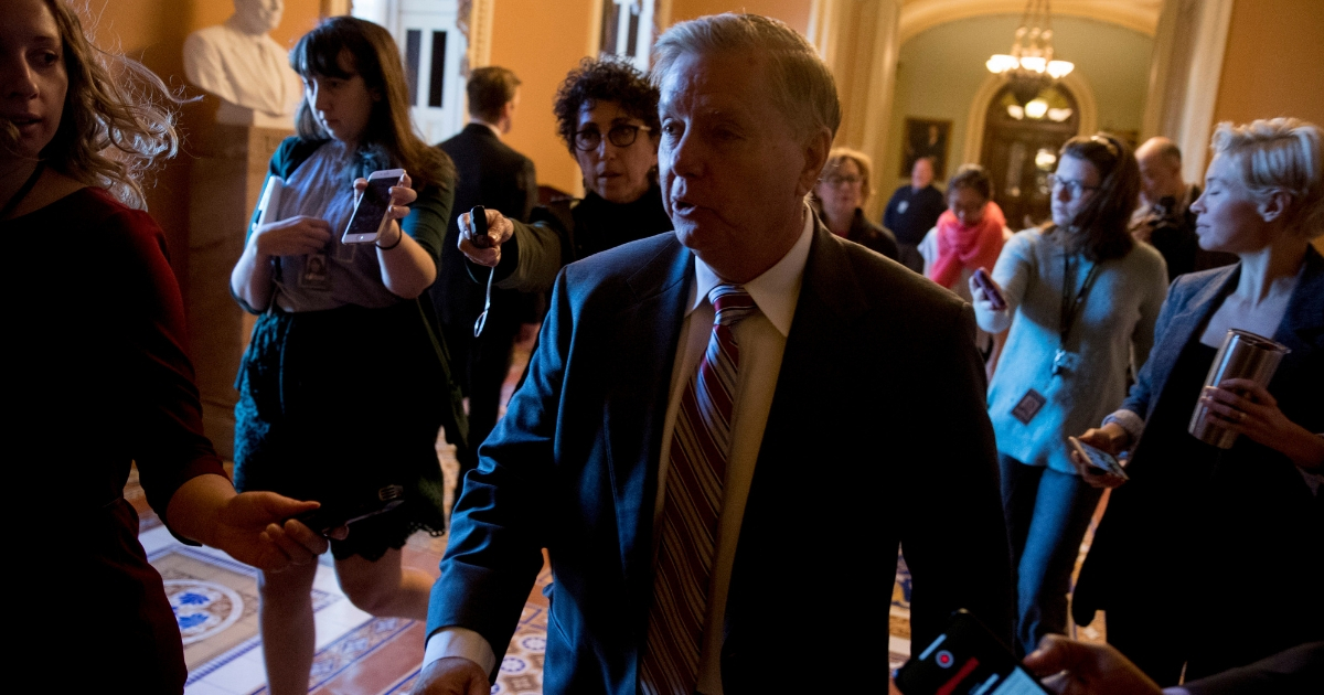 Sen. Lindsey Graham, R-S.C., speaks to reporters as he walks to a meeting with Senate Republicans at the office of Senate Majority Leader Mitch McConnell on Capitol Hill in Washington, Jan. 10, 2019.