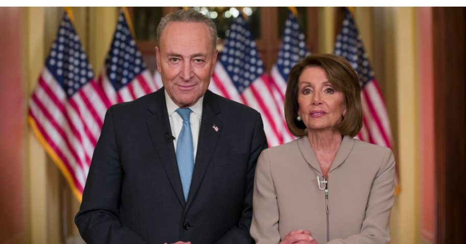 Senate Minority Leader Chuck Schumer of New York and House Speaker Nancy Pelosi of California pose for photographers after speaking on Capitol Hill in response President Donald Trump's address, Jan. 8, 2019, in Washington.