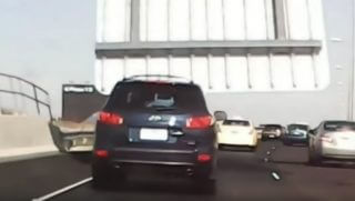 A freeway sign in Australia crashes down on an SUV.