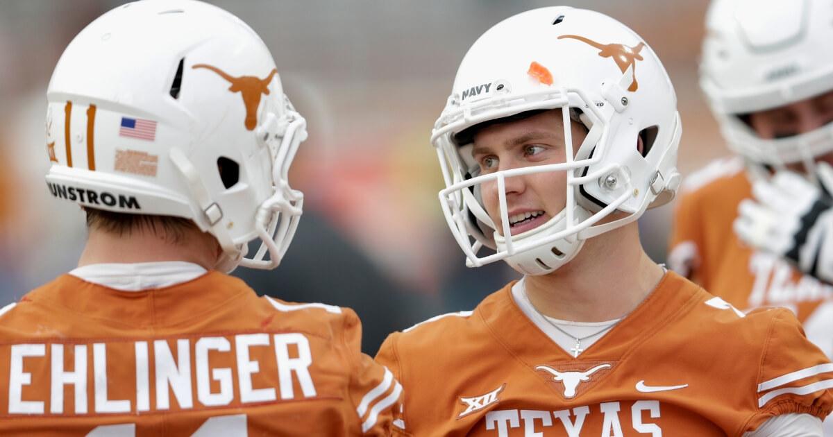 Shane Buechele, right, talks with fellow Texas Longhorns quarterback Sam Ehlinger #11 of the Texas Longhorns before a Nov. 11, 2017, game against the Kansas Jayhawks.
