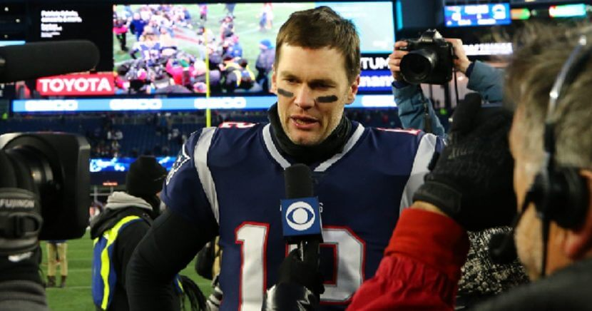 New England Patriots quarterback Tom Brady is interviewed on the field after his team's win against the Los Angeles Charges on Sunday.