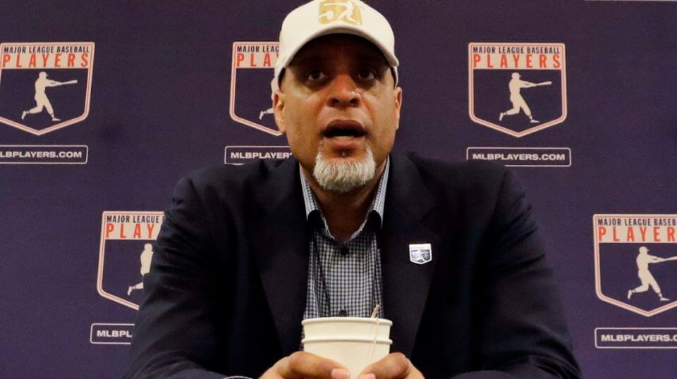 Tony Clark, executive director of the Major League Players Association, answers questions at a news conference in Phoenix on Feb. 19, 2017.