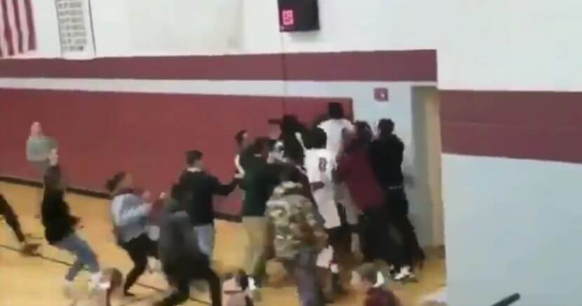 Students and players at Sabis International Charter High School in Springfield, Massachusetts, celebrate after sophomore guard Tre Hodge hit a three-quarter-court buzzer-beater to win the game.