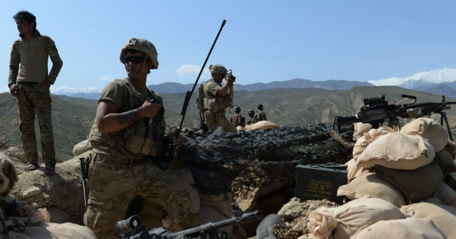 In this photograph taken on April 11, 2017, U.S. soldiers take up positions during an ongoing an operation against Islamic State militants in the Achin district of Afghanistan's Nangarhar province.
