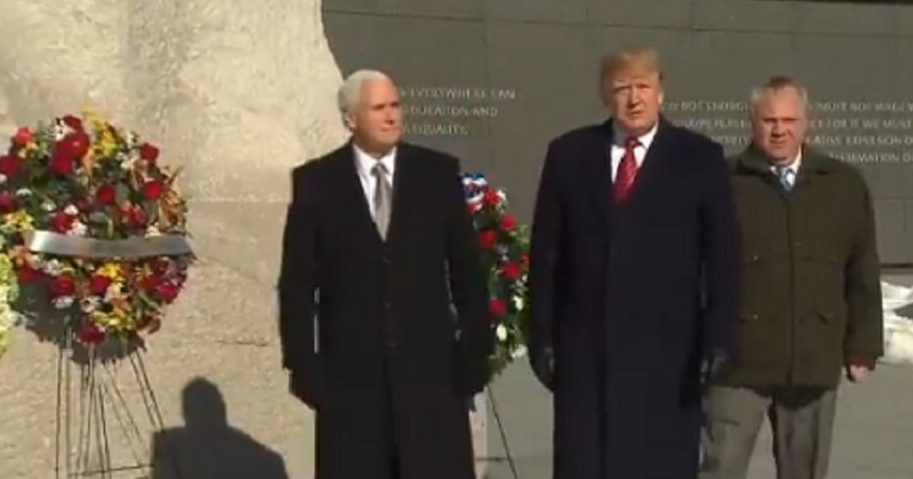 President Donald Trump with Vice President Mike Pence, left, paid an unannounced visit to the Martin Luther King memorial in Washington on Monday in honor of Martin Luther King Jr. Day.