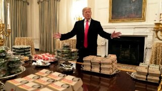 President Donald Trump presents the banquet of fast food being served Monday for the White House visit of the national champion Clemson Tigers college football team.