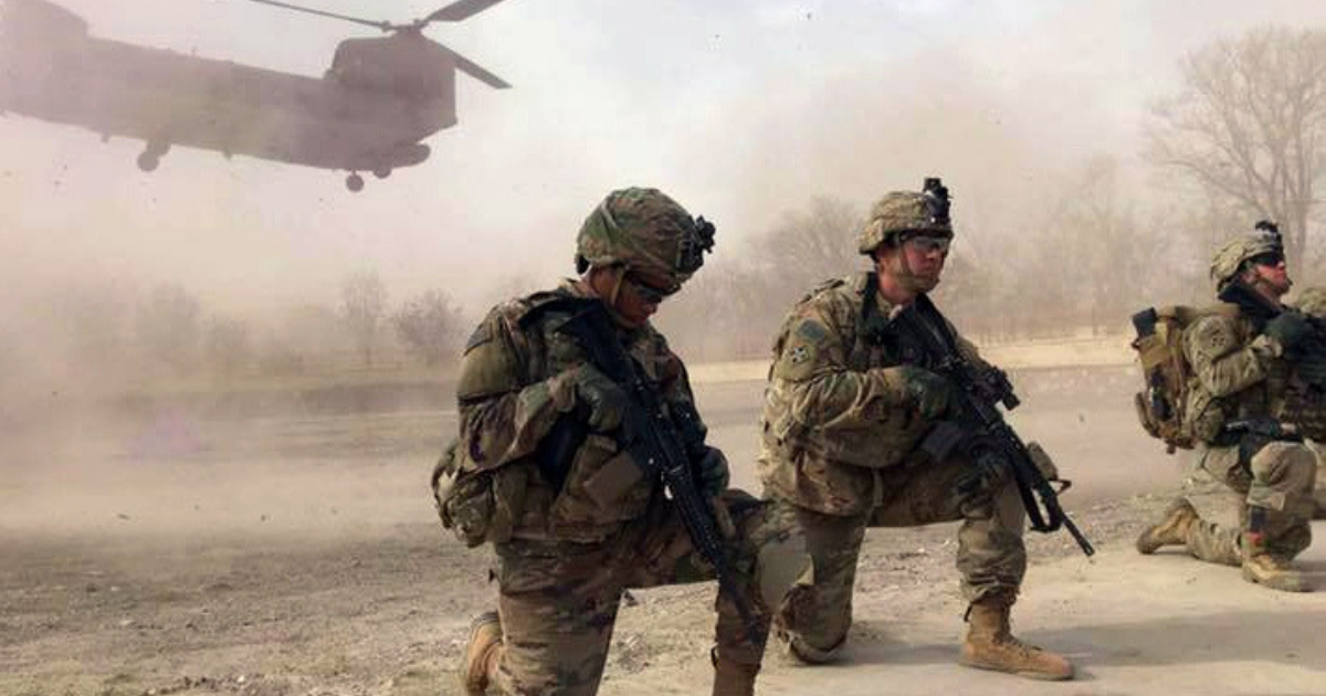 U.S. soldiers secure a landing zone for a CH-47 Chinook helicopter during combat operations in Afghanistan on Nov. 21.