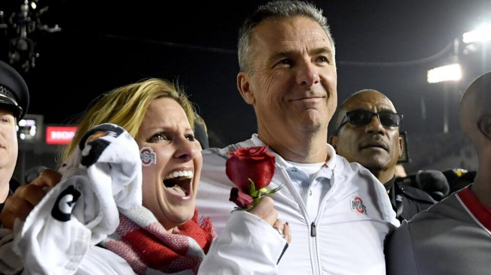 Ohio State football coach Urban Meyer and his wife, Shelley, celebrate after the Buckeyes won the Rose Bowl on Tuesday.