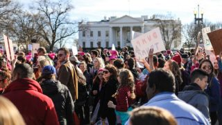 Women's March demonstrators gather in Lafayette Square in January 2018.