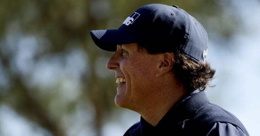 Phil Mickelson smiles after his tee shot on the fourth hole during the third round of the Desert Classic golf tournament on the Stadium Course at PGA West on Saturday in La Quinta, Calif.