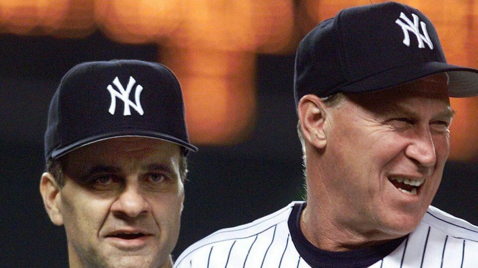 In a Aug. 27, 1999, file photo, New York Yankees manager Joe Torre, left, and pitching coach Mel Stottlemyre head onto the field to congratulate their players after the Yankees defeated the Seattle Mariners 8-0 in New York.