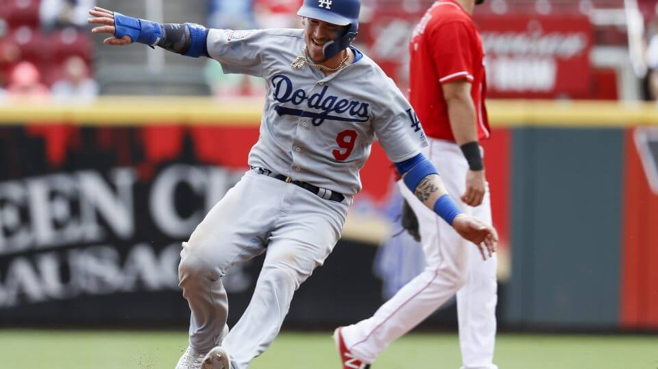 Yasmani Grandal advances to second on an error during the Los Angeles Dodgers' Sept. 12 game against the Cincinnati Reds.