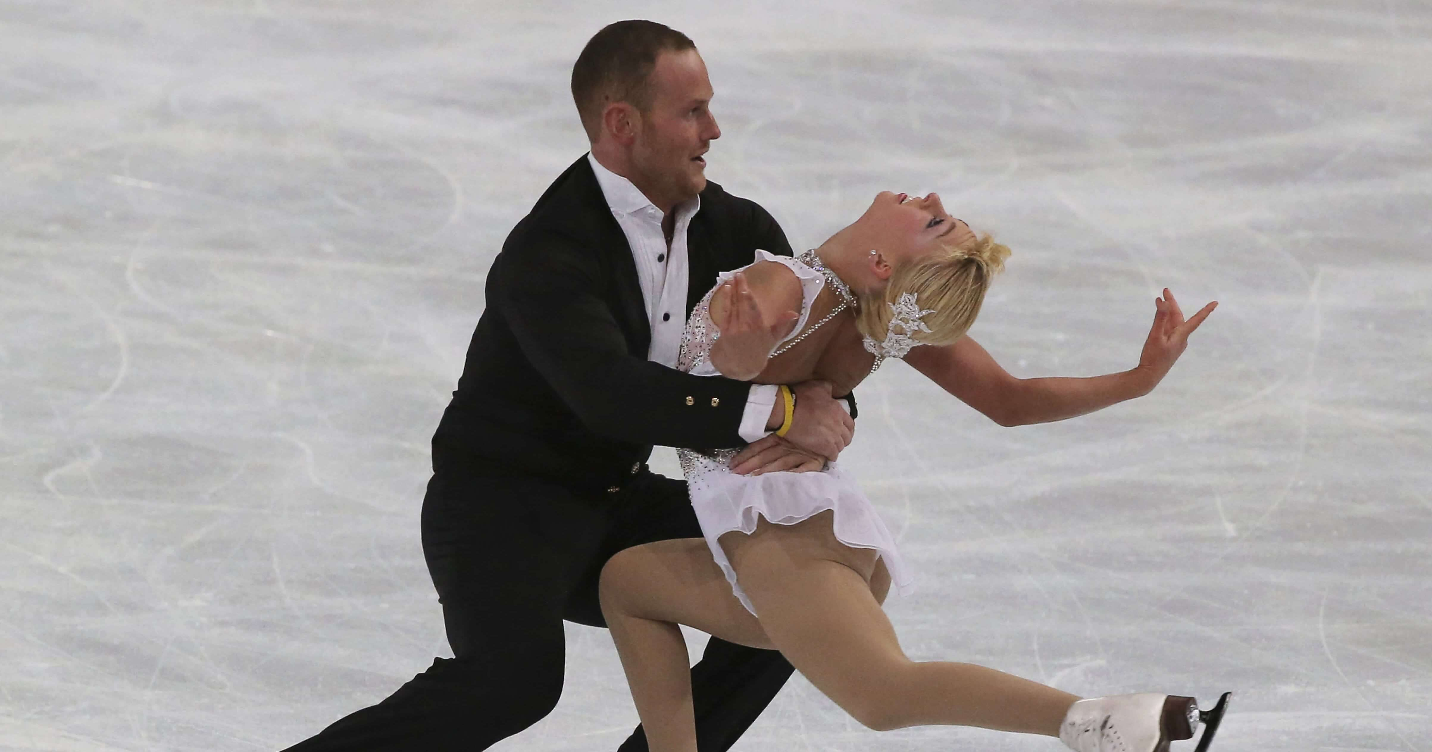 Caydee Denney and John Coughlin perform in the pairs free skate at the ISU Figure Skating Eric Bompard Trophy on Nov. 16, 2013, at Bercy arena in Paris.
