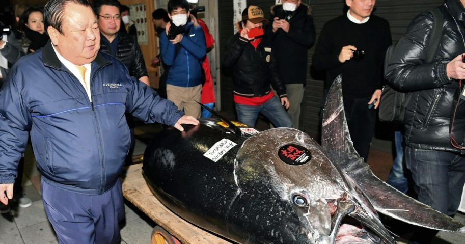 Kiyomura Corp. owner Kiyoshi Kimura stands near the bluefin tuna for which he made a wining bid at the annual New Year auction, in Tokyo, Jan. 5, 2019.