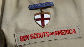 In this Feb. 4, 2013 file photo, shows a close up detail of a Boy Scout uniform worn during a news conference in front of the Boy Scouts of America headquarters in Irving, Texas.