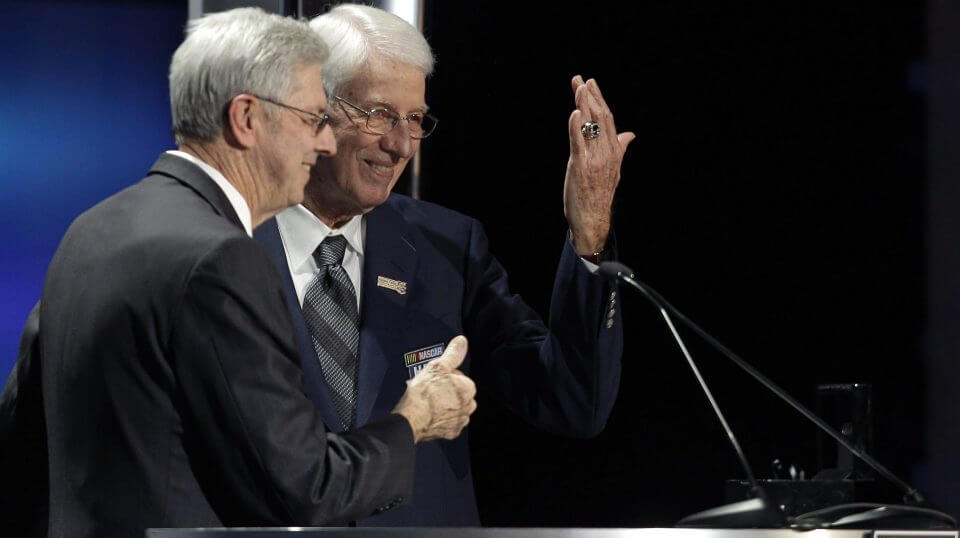 Glen Wood, right, shows off his induction ring as his brother, Leonard, left, looks on Jan. 20, 2012, during the NASCAR Hall of Fame induction ceremony in Charlotte, North Carolina.