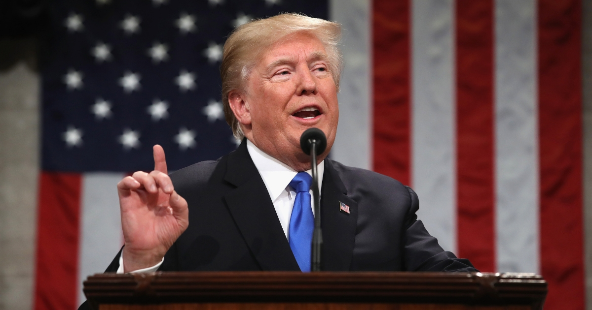 President Donald Trump gestures during the State of the Union address.