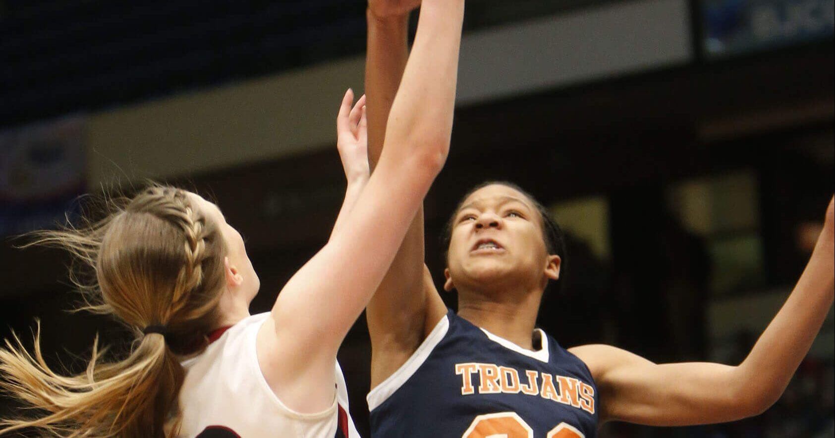 Oneonta's Abby Blackwood, left, shoots over Charles Henderson's Maori Davenport in a girls' Class 4A state basketball semifinal in Birmingham, Alabama, on Feb. 26, 2014.