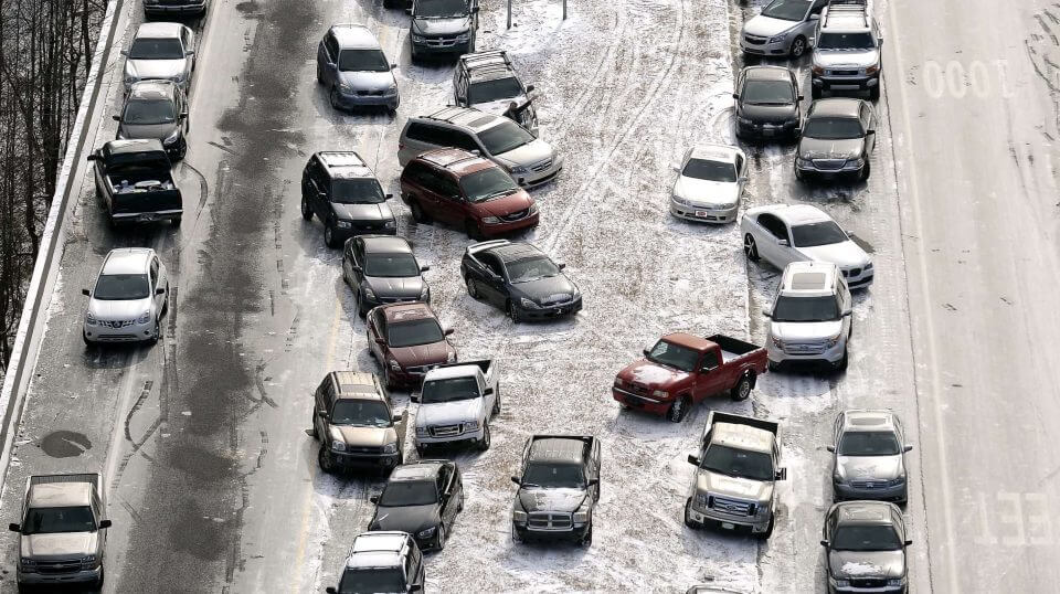 A Jan. 29, 2014, aerial photo shows abandoned cars at I-75 near the Chattahoochee River overpass piled up in the median of the ice-covered interstate after a winter snow storm in Atlanta.
